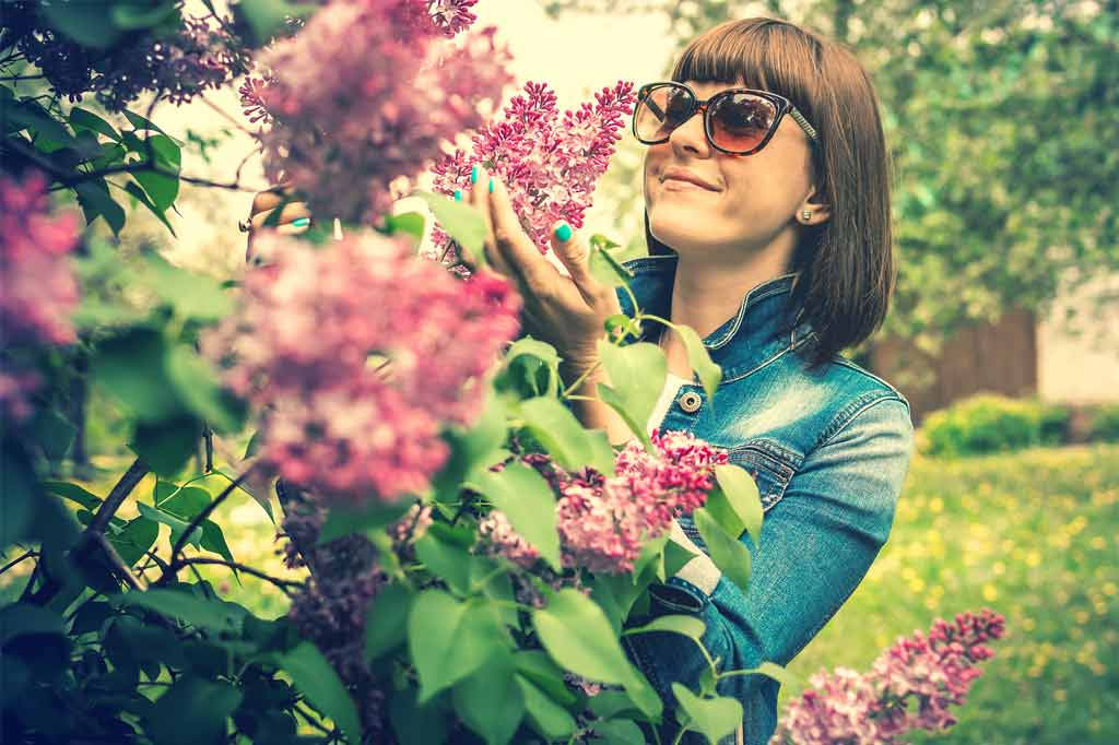 Woman feeling free after she has How To Uncovered Limiting Beliefs and has found love.