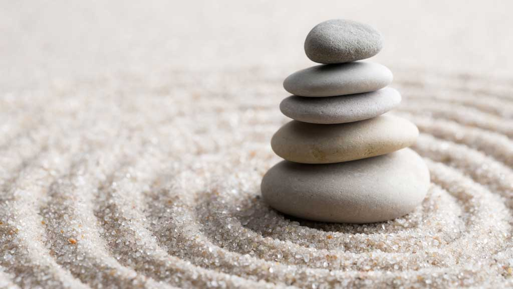 Serene stacked rocks helping make right right decisions.